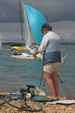 Marine Artist. Hilary Thorpe at work by the water's edge of the Solent during international sailing event Cowes Week. Isle of Wight, England Royalty Free Stock Photography