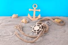 Marine attributes, Decorative steering wheel and steering wheel with seashells stock photo