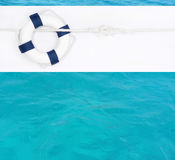 Marine background with blue lifebuoy for a postcard or a concept Royalty Free Stock Image