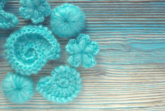 Marine background with cotton lace crochet elements: stars, shells, flowers Royalty Free Stock Photos