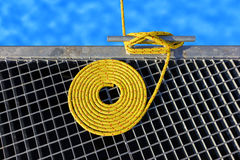 Marine background made of mooring rope with a cleat. Stock Photo