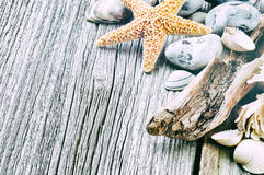 Marine background with pebbles and starfish Stock Photo