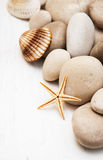 Marine background with pebbles and starfish Royalty Free Stock Photos