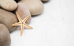 Marine background with pebbles and starfish Royalty Free Stock Photography