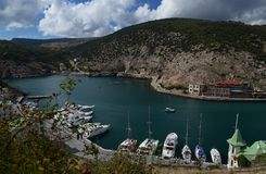 Marine Bay with Ukrainian ships against a background of mountains royalty free stock photo