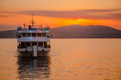Marine boat against  background of mountains at sunset Royalty Free Stock Photo