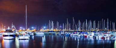 Marine boats night water sea lights colorful Royalty Free Stock Photo