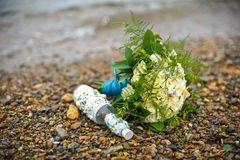 Marine bouquet on the rocky shore Stock Images
