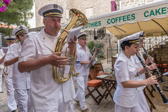 Marine brass band goes through the streets of Budva on  holiday of St. Trinity Stock Photo