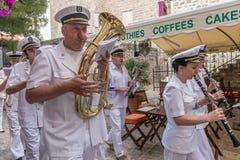 Marine brass band goes through the streets of Budva on  holiday of St. Trinity Stock Photo