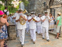 Marine brass band goes through the streets of Budva on  holiday of St. Trinity Royalty Free Stock Image