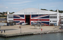 Marine business premises Venture Quays UK. Venture Quays at East Cowes Isle of Wight and the Columbine building with a large Union Jack covering the sliding Royalty Free Stock Image