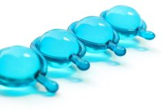 Marine capsules. The blue colour of marine capsules produce for cosmetic Stock Photo