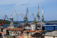 Marine cargo port. Cranes. Pula Royalty Free Stock Photos