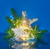Marine Christmas Decoration med felika ljus Arkivfoton