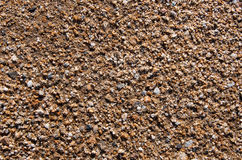 Marine clean sand with small colored stones Stock Images
