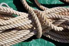 Marine clear white used rope over green Royalty Free Stock Photography
