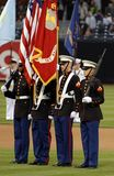 Marine Corps Color Guard. Four members of a United States Marine Corps Color Guard during a baseball game stock image