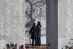 Marine corps memorial wall NY detail. A couple reading inscriptions at Marine corps memorial wall located in manhattan, US Royalty Free Stock Photography