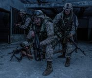 Marine Corps soldier fighters breakthrough with firefight stock photos