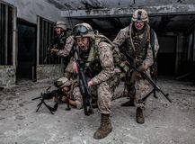 Marine Corps soldier fighters breakthrough with firefight stock photography