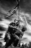 Marine Corps War Memorial. Or Iwo Jima Memorial statue with American flag in black and white. Arlington, Virginia, United States Royalty Free Stock Photo