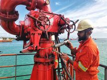 Free Marine Crew Servicing FiFi Water Monitor Royalty Free Stock Photos - 176582458
