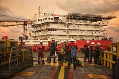 Marine crew stand by for crew transfer operation royalty free stock image