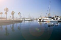 Marine d'Alicante avec un soleil photos stock