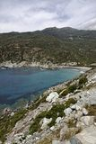 Marine de Giottani, Cap Corse, gravel beach at the west coast with a little harbor and the small hotel, Corsica, France Royalty Free Stock Photography