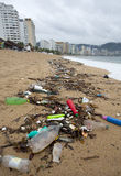 Marine Debris. A line of debris covering the beach of Acapulco, Mexico after a storm. The trash comes from runoff from storm drains that empty into the bay and Royalty Free Stock Photography