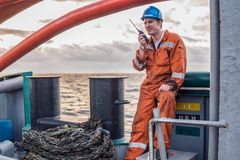 Marine Deck Officer or Chief mate on deck of ship with VHF radio Royalty Free Stock Photo