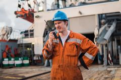 Marine Deck Officer or Chief mate on deck of ship with VHF radio Royalty Free Stock Images