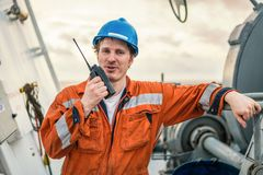 Marine Deck Officer or Chief mate on deck of ship with VHF radio Stock Photos