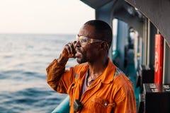 Marine Deck Officer of eerste stuurman op dek van schip of schip stock foto's