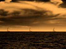 Marine desert storm. Desert colors in the stormy sky over the sea. Toned image Royalty Free Stock Image