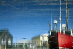 Marine Dock Reflected. Showing red fishing boat Stock Photography