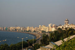Marine Drive, Mumbai. A view looking north along Marine Drive and Back Bay in the city of Mumbai (formerly Bombay) with the Indian Ocean lapping against the Royalty Free Stock Photo