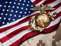 Marine Eagle, Globe and Anchor. Marine eagle, globe and anchor with American flag background royalty free stock images