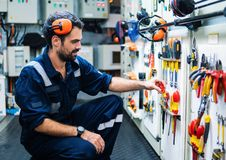 Marine engineer officer working in engine room stock image