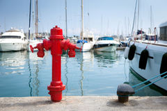 Marine fire hydrant on the quay in front of the yachts royalty free stock photo