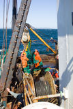 Marine fishing 1. The trawler pulls snurrevaad from the waters of the Pacific ocean royalty free stock photography