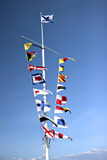 Marine flags of different countries on a mast Stock Photography