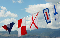 Marine flags 1. Variety of marine international signal flags on a passenger ship Royalty Free Stock Image