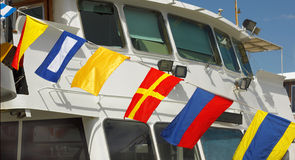 Marine flags 2. Variety of marine international signal flags on a passenger ship Royalty Free Stock Photos