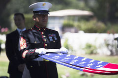 Marine folds flag at Memorial Service for fallen US Soldier, PFC Zach Suarez, Honor Mission on Highway 23, drive to Memorial Servi. Ce, Westlake Village Royalty Free Stock Photos