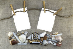 Marine frame with clothespins Royalty Free Stock Images