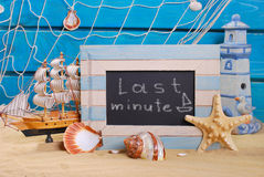 Marine frame with last minute offer written on  blackboard Stock Photography