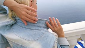 Marine French nail designs . Marine French nail designs for short nails girl in jeans clothes on the sea close up stock image