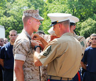 A marine gets a promotion. A marine gets a promotion in a ceremony which was taken place in Stock Photography